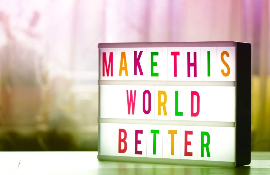 Insegna Make this world better